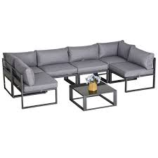 glass coffee table cushioned chairs