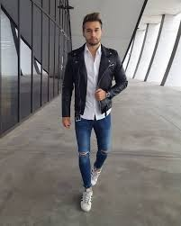 leather biker jacket on down white shirt blue jeans and white sneaker