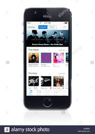 Apple Iphone 5s With Itunes Music Store On Its Display