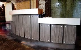reception desk front wall idea english walnut panels with stand offs