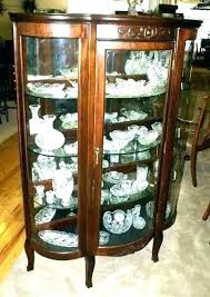 a lovely edwardian mahogany and inlaid bow fronted display cabinet having a central bowed panel with inlaid recessed wooden panel flanked on either s