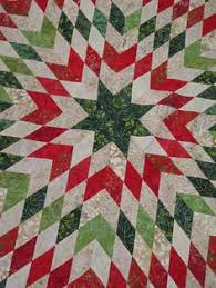 A red and white stunner using flannels. | Red, White & Green ... & Yuletide Snowflake Quilt. Kits available at www.hollyhillquiltshoppe.com Adamdwight.com