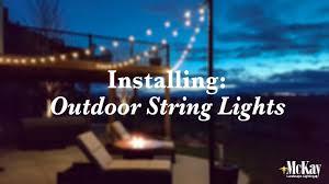How To Hang Outdoor String Lights On Stucco Installing Outdoor Bistro String Lights Behind The Scenes Installation Omaha Nebraska