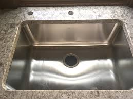 the stainless steel undermount sink is also installed with the countertops