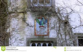 picturesque old house with bird decoration surrounded by trees at edinburgh city scotland