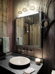 mens apartment bathroom ideas with rustic wooden wall decor and cool floating lamp plus framed wall mirror above washbasin