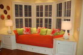 Colorful Orange Bay Window Couch Idea With Green Fresh Cushions Beneath  Glass White Drape And Table ...