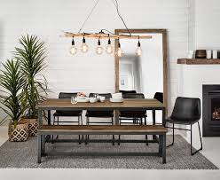 grey pattern rug under brown timber industrial dining table from freedom
