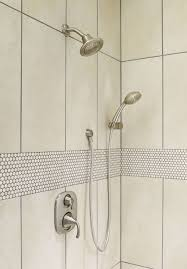 moen 600bb brushed bronze pressure balanced shower system with diverter integrated volume control slide bar and hand shower from the icon collection