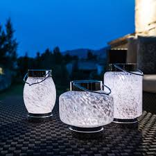 garden decoration items like hand blown glass boaters lanterns and hanging solar terrariums boaters lanterns