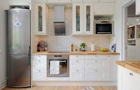 elegant tall white upper kitchen cabinet with glass door and wall microwave shelf also wooden