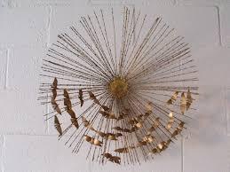 gold sunburst wall art with birds