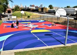 Basketball is a team sport in which two teams of five players score points by shooting (throwing) a ball through an elevated hoop located on either side of the rectangular court. Covington Basketball Court Gets Colorful Makeover In Honor Of Homegrown Star The River City News