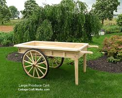 old fashion reion large wooden produce cart wagons barrows farm garden