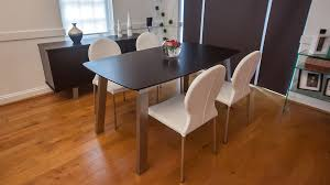 wenge wood veneer extending dining table and white chairs