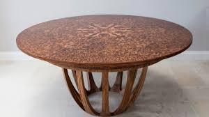 expanding circular dining table in brown oak burr