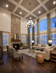 Large living room with coffered ceiling, stone fireplace, dark wood floors,  floor to