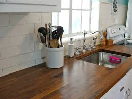 kitchen white tiles ikea backsplash with glass windows and brown varnished wooden countertop and silver