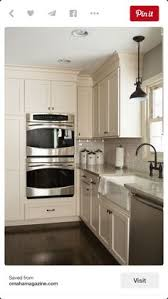 off white cabinets dark floors. oil rubbed bronze finishes with white cabinets and stainless steel appliances off dark floors