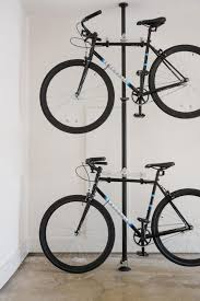 Two Fairdale bicycles designed by Austin bikers for the streets of Austin  are stored smartly in the garage bike rack to conserve space.