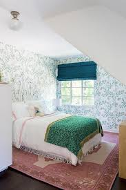 whimsical girls bedroom with pink rug under bed
