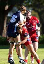 women s rugby team seaman communication and information systems nikki davies gets tackled with the ball by a french navy