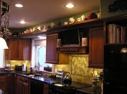 decorating above kitchen cabinets interior improvement 700 x 525