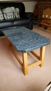 handmade solid oak coffee table with a solid blue pearl marble top