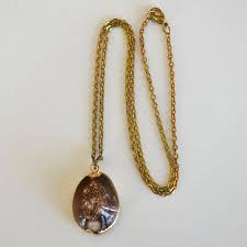 necklace with cowrie shell pendant trimmed with gold to expand