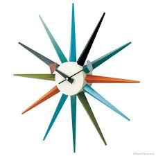 sunburst and atomic design clocks of