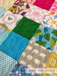 crazy mom quilts: Machine Quilting 101:Picking a Pattern & On this patchwork quilt, I quilted loops down the center of each row,  eyeballing the line of stitching down the middle. The squares finish at  2.5