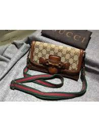 gucci 409527. gucci gg supreme canvas lady web hand-stained convertible wallet 382275 409527