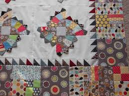 Borders: 1/2 square triangles! - Color Girl Quilts by Sharon McConnell & Blog Adamdwight.com