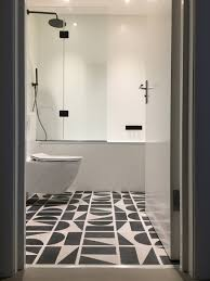 black and white floor tiles wall hung wc white bathroom black taps