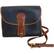 to expand vintage dooney bourke all weather leather cross shoulder bag black brown