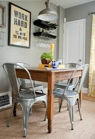 really like the combination of the old wooden table and the metal bistro chairs and the work hard be nice to people sign neutral colors with a pop of