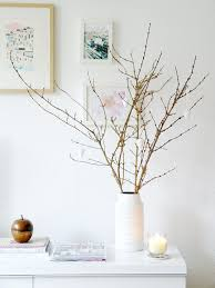 A. Bringing in fresh blooms, herbs, branches or cuttings from outside is a  great inexpensive way. They instantly freshen a space and add an earthy  vibe.
