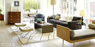 bright rugs living room orange velvet sofas chevron rug areas white coffee table wood colored