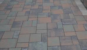choosing brick vs concrete pavers for a