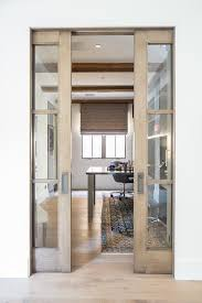 wood and glass pocket office doors transitional den library throughout plan 12
