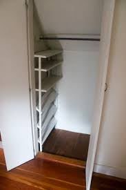 i was delighted to see this shoe rack tucked into the far edge of a small closet