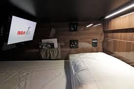 The Interior Of A Tour Bus Bunk.