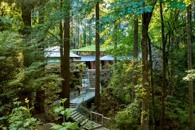 the entrance pathway winds through oregonian woodland to the portland japanese garden s cultural village photograph by james florio all photographs