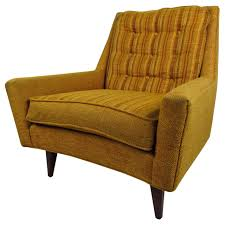 midcentury modern upholstered lounge chair with tufted back for