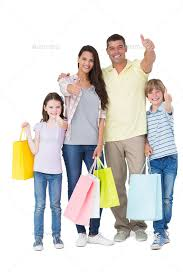 portrait of happy family with ping bags gesturing thumbs up over white background stock photo by wavebreakmedia