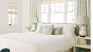 In this Manhattan Beach bedroom, the soft, watery tones in the aqua dhurrie  rug