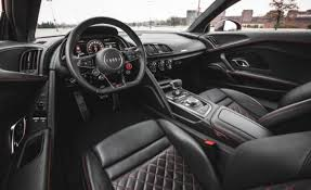 audi r8 interior. the interior looks sporty and elegant offering a new restyled instrument cluster with graphics as well center display mounted right behind audi r8