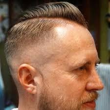 thin hair b over pomp skin fade beard