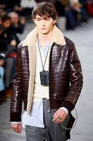 a model wears a creation for louis vuitton men s fall winter 2017 2018 fashion collection