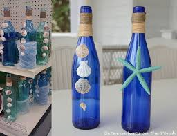 A detailed tutorial showing how to decorate bottles with shells for summer  beach themed decor.